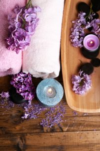 Composition with spa treatment, wooden bowl with water, towel